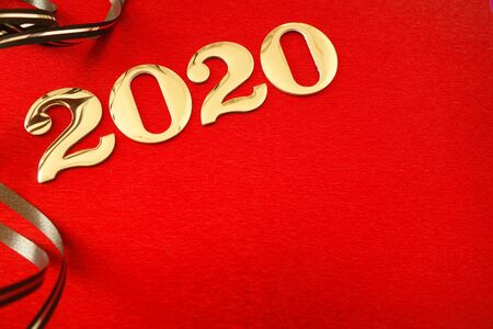Number 2020 and ribbons on red background, New Year celebration