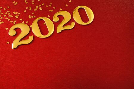 Golden number 2020 on red background, New Year celebration, space for your design