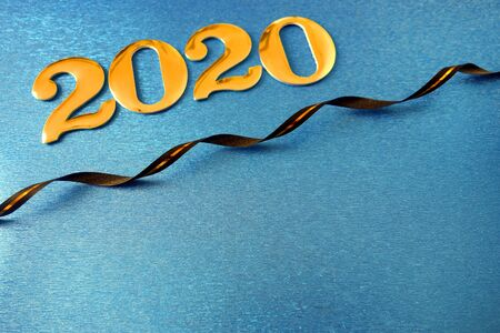 Number 2020 on blue background with ribbon, New Year celebration, copy space for your design