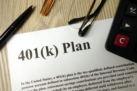 401k Plan with calculator pen and glasses, retirement planning