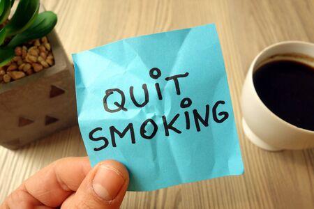Quit smoking text - motivational reminder handwritten on sticky note
