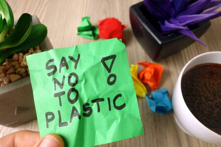 Slogan say no to plastic handwritten on sticky note, environment protection and save planet concept Stock Photo