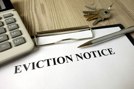Home eviction notice document with pen calculator and keys, legal concept Stock fotó