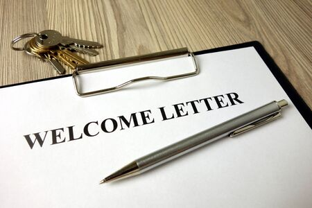 Welcome letter with pen and keys, business concept
