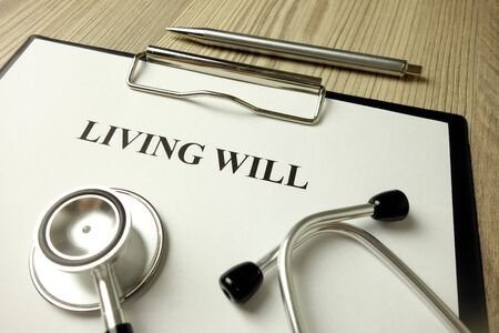 Living will directive with stethoscope and pen, medical or legal concept
