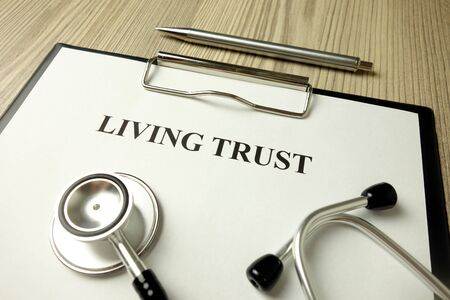 Living trust document with stethoscope, estate planning concept Standard-Bild