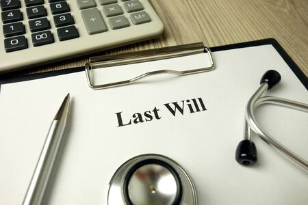 Last Will directive with stethoscope calculator and pen, legal concept Standard-Bild