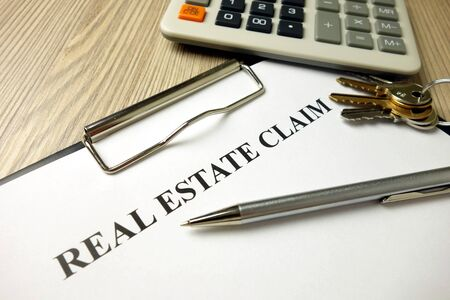 Real estate claim form with pen keys and calculator, business concept Standard-Bild
