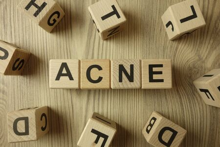 Word acne from wooden blocks on desk