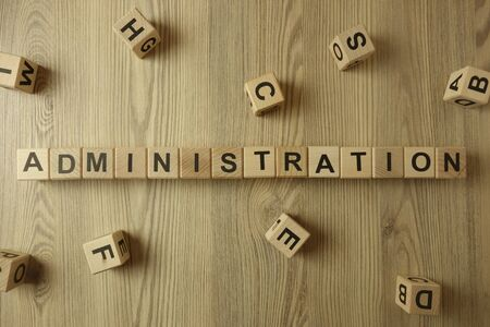 Word administration from wooden blocks on desk