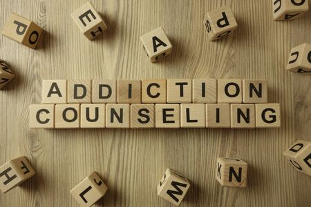 Text addiction counseling from wooden blocks on desk