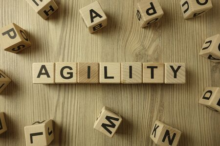 Word agility from wooden blocks on desk