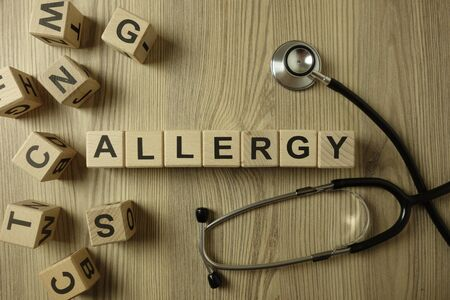 Word allergy from wooden blocks with stethoscope, medical concept