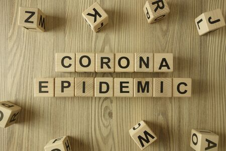 Text corona epidemic from wooden blocks, healthcare and medical concept