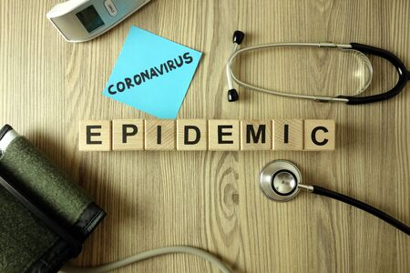 Text coronavirus epidemic with medical accessories, healthcare concept