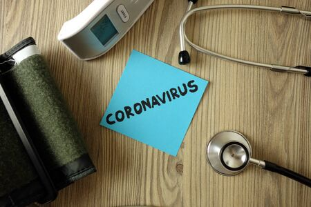 Word coronavirus with medical accessories, healthcare concept Standard-Bild