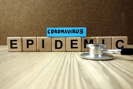Text coronavirus epidemic with stethoscope, healthcare concept