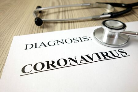 Text diagnosis: coronavirus on medical document with stethoscope, healthcare concept