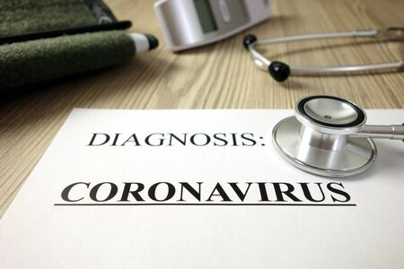 Text diagnosis: coronavirus on medical document with accessories, healthcare concept
