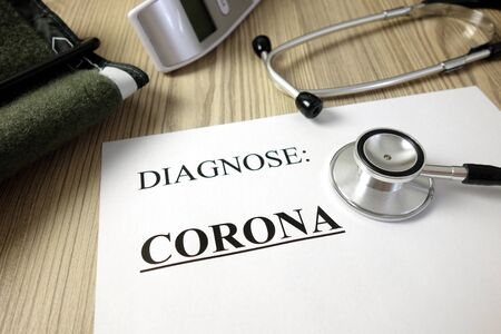 Text diagnose: corona (German: diagnosis: coronavirus) on medical document with accessories, healthcare concept