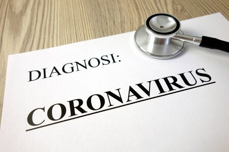 Text diagnosi (Italian: diagnosis) coronavirus on medical document with stethoscope, healthcare and medicine concept