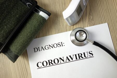 Text diagnosi (Italian: diagnosis) coronavirus on medical document with accessories, healthcare and medicine concept Standard-Bild