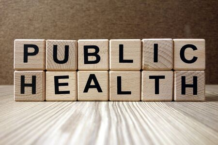 Text public health from wooden blocks, healthcare and medical concept
