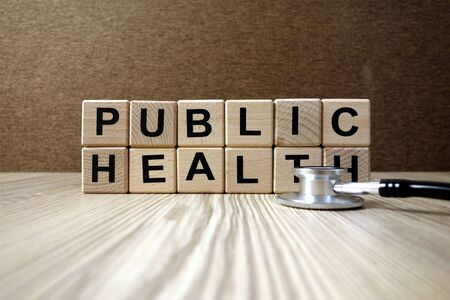 Text public health from wooden blocks with stethoscope, healthcare and medical concept