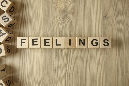 Word feelings from wooden blocks on desk Standard-Bild