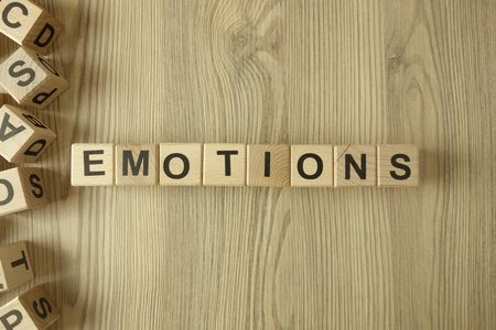 Word emotions from wooden blocks on desk Standard-Bild