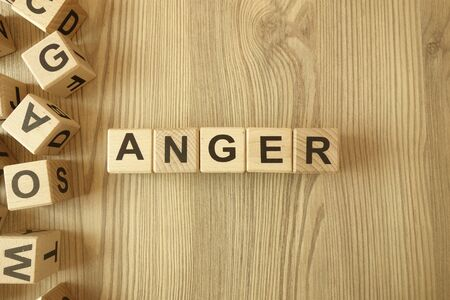 Word anger from wooden blocks on desk