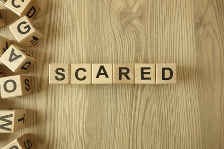 Word scared from wooden blocks on desk