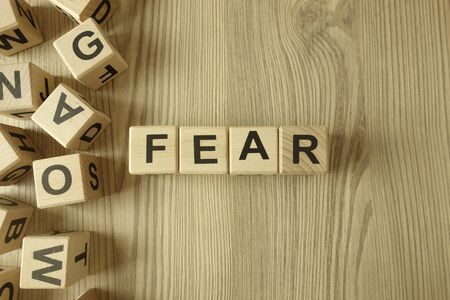 Word fear from wooden blocks on desk Standard-Bild