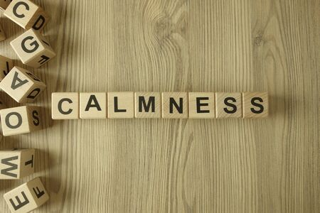 Word calmness from wooden blocks on desk