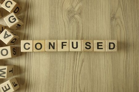Word confused from wooden blocks on desk Standard-Bild