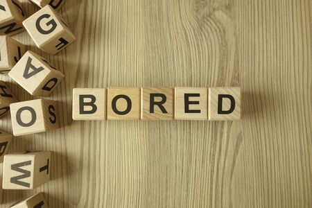 Word bored from wooden blocks on desk Standard-Bild