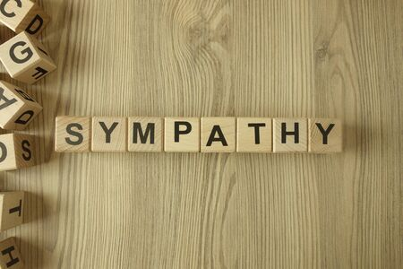 Word sympathy from wooden blocks on desk
