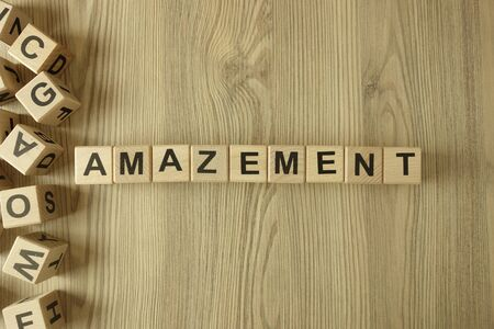Word amazement from wooden blocks on desk
