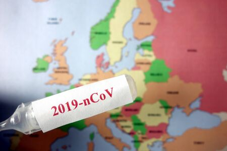Ampoule with text 2019-nCoV and map of Europe. Coronavirus spreading in European countries concept Standard-Bild - 143382357