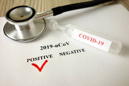 Positive blood test result for Coronavirus on doctor office desk, 2019-nCoV spreading concept Standard-Bild - 143383467