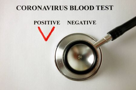 Positive blood test result for Coronavirus and stethoscope, Covid-19 diagnosis concept Standard-Bild - 143383441