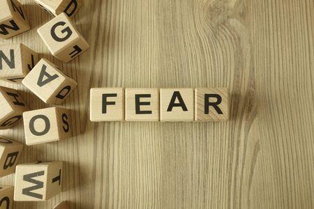 Word fear from wooden blocks on desk Standard-Bild