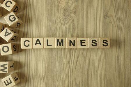Word calmness from wooden blocks on desk