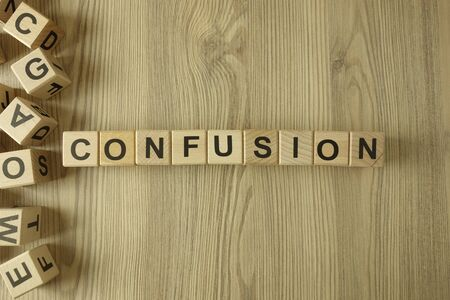 Word confusion from wooden blocks on desk