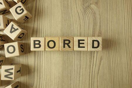 Word bored from wooden blocks on desk Standard-Bild