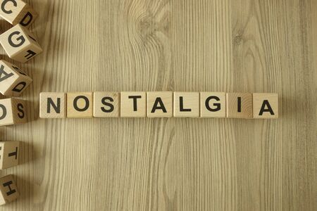 Word nostalgia from wooden blocks on desk Standard-Bild - 144898755