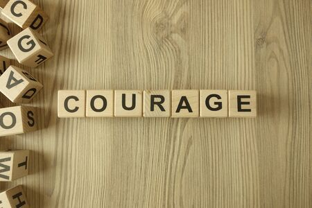 Word courage from wooden blocks on desk Stock Photo