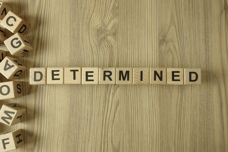 Word determined from wooden blocks on desk