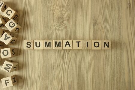 Word summation from wooden blocks on desk Zdjęcie Seryjne