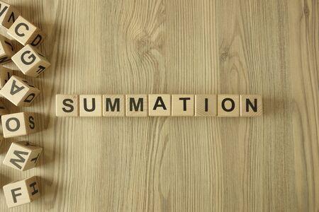 Word summation from wooden blocks on desk